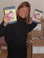 Elke with copies of her book